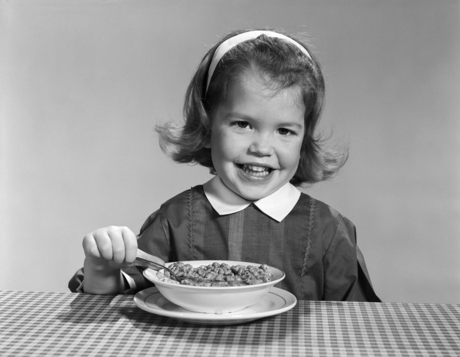 Child eating cereal in 1950s_routine_habits